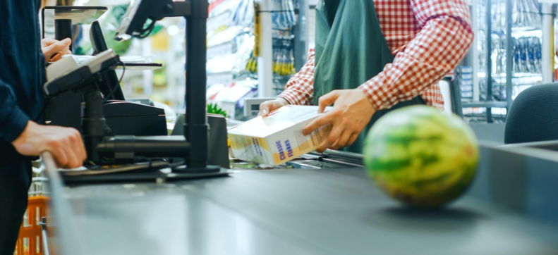 Cashier scanning product