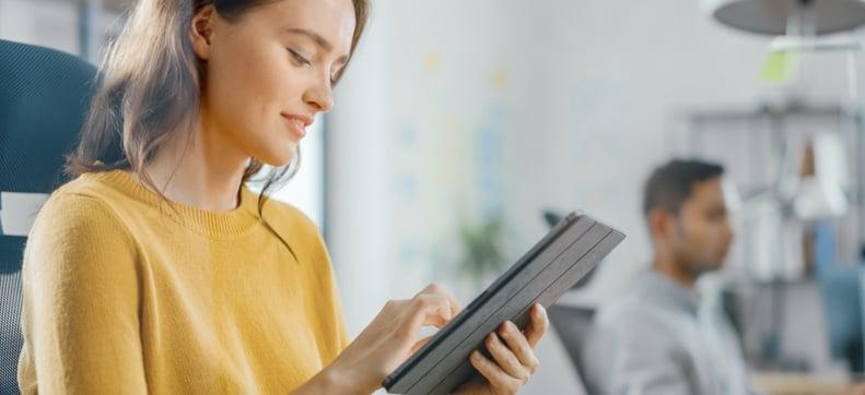 Female office worker on tablet