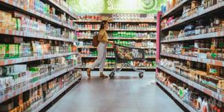Woman pushing trolley in grocery retailer