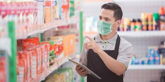 Retail employee checking products on shelves