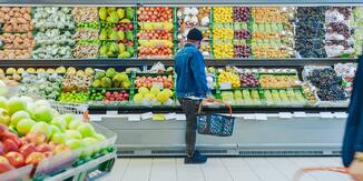 Customer browsing fruit at grocery retailer