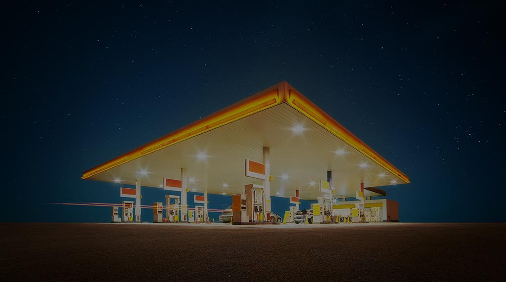 Unbranded Gas station with retail convenience store at night time