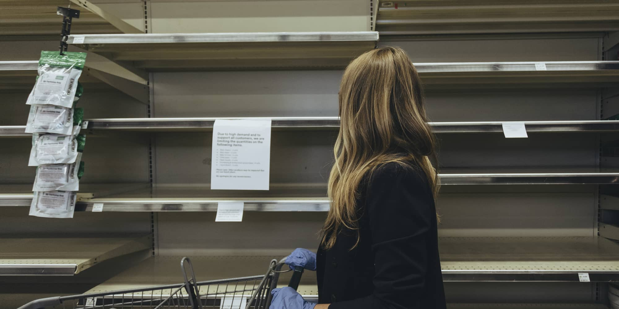 Grocery retail customer looking at empty shelves